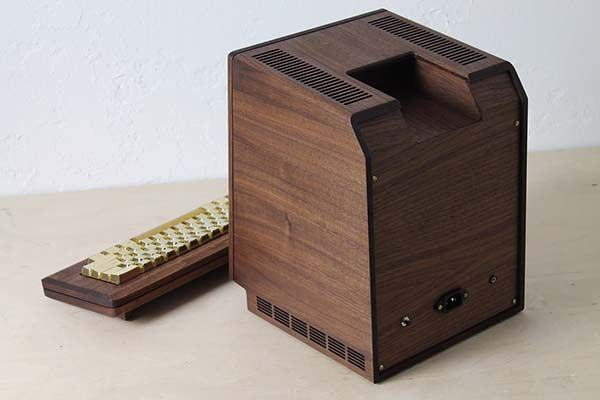 The Macintosh 128k Replica with a Wooden Housing and Gold Keyboard
