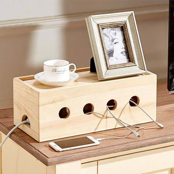 The wooden cable organizer box hides your power strip and Diy cable organizer